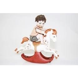 Bimbo su cavalluccio - porcellana di capodimonte