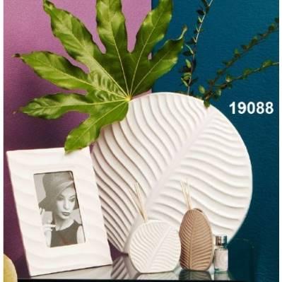 Vaso trama foglia forma tonda in porcellana
