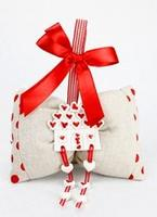 Cuscinetto portaconfetti in tela con accessorio in ceramica