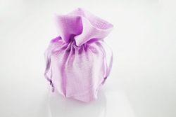Scatola dentro saccoccino di colore rosa