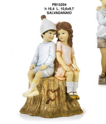 Salvadanaio Fratelli o fidanzatini seduti su tronco - Mandorle